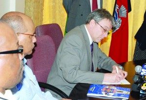 Capita Symonds Associate Director Paul Wadsworth signs the agreement that will foresee the continued consultancy of the firm in the development of the Guyana Police Force