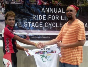 "Paul DeNobrega receives a jersey from Team Coco's owner, Ian ""QB"" Davis, after copping the junior title of the ""Ride for Life"" Five-Stage cycling event last year"