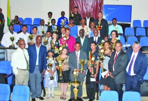 Dr Frank Anthony (second right); Director of Sport Neil Kumar (left); Permanent Secretary within the Sport Ministry, Alfred King (second left) pose with awardees and other officials after the award ceremony (Photo: Carl Croker)