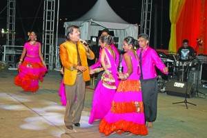 Udit Narayan during one of his performances accompanied by members of the Sabha's Dharmic Nritya Sangh