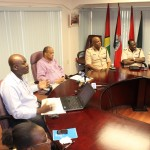 Information specialist Floyd Levi and Home Affairs Minister Clement Rohee at the launch of the website ipaidabribe.gy, along with police top brass