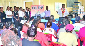 Prime Minister Samuel Hinds interacting with One Laptop Per Family (OLPF) beneficiaries from Goedverwagting and its environs
