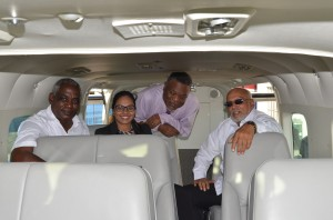 President Donald Ramotar, Prime Minister Samuel Hinds and Transport Minister Robeson Benn along with Director of JAGS Aviation, Briony Tiwari inside the new Cessna Grand Caravan