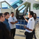 BK Group of Companies Chairman Brian Tiwari and US Embassy Charge d'Affaires Bryan Hunte being told about the Cessna Grand Caravan