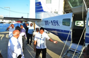 Brian Tiwari escorting President Ramotar for a tour of the Cessna Grand Caravan, recently bought by JAGS Aviation