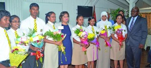Education Minister Priya Manickchand, Chief Education Officer, Olato Sam and some of the 2014 top students