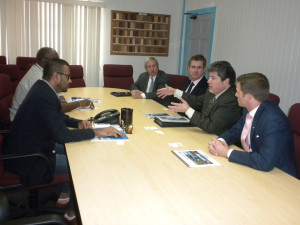 Natural Resources and Environment Minister Robert Persaud and acting Commissioner of the Guyana Geology and Mines Commission Newell Dennison meeting with the team from HESS Corporation