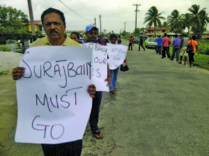 The protest headed by former Minister within the Agriculture Ministry and PPP/C representative Alli Baksh in front of GECOM Office at Bush Lot in Region Two