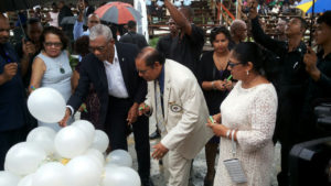 President David Granger and Prime Minister Moses Nagamootoo along with their spouses writing their personal commitments to the promotion of social cohesion on white helium-filled balloons, which were later released up into the sky (Ministry of the Presidency photo)