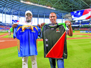 Steven Taylor of the Barbados Tridents and Samuel Badree of the St Kitts and Nevis Patriots at a baseball arena in the USA