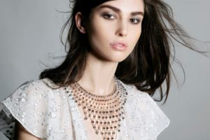 """A model presents a bib necklace piece similar to one worn in an episode of TV show """"Reign"""""""