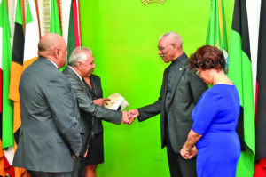 President David Granger exchanges a handshake with the newlyaccredited Ambassador Jose Kinn Franco after the ceremony at State House on Wednesday
