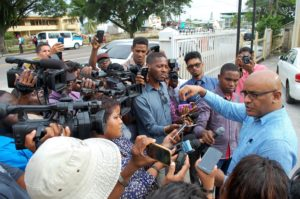 Opposition Leader  Dr. Bharrat Jagdeo speaking to the media after he was released by SOCU agents