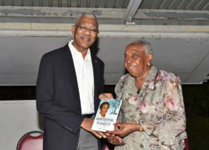 Carmen Jarvis presenting a copy of her autobiography to President David Granger in October