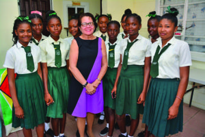 First Lady Sandra Granger poses with some Grade Nine students enrolled at the Agricola Practical Instruction Centre