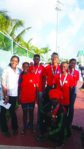 Jamaica breast stroke Olympic gold medallist Alia Atkinson (left) strike a pose with back row  from left: Daniel Scott, Alex Winter and chaperone Shonette Winter; middle row are Lian Winter and Leon Seaton Jr while coach Shefetah Tzedeq is stooping